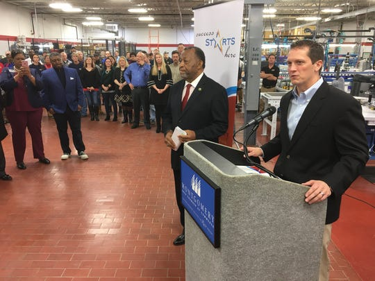 Hartzell Engine Technologies President Keith Bagley, right, speaks during an event Friday at the Montgomery plant.