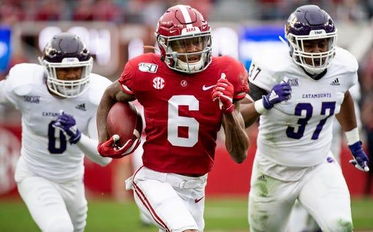 Alabama wide receiver DeVonta Smith (6) scores a touchdown against Western Carolina at Bryant-Denny Stadium in Tuscaloosa, Ala., on Saturday, November 23, 2019.