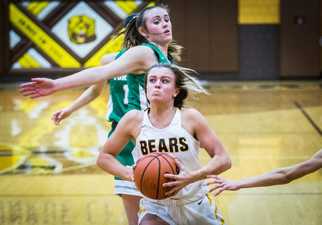 Monroe Central's Hannah Bolton slips past Yorktown's defense during their game at Monroe Central High School Thursday, Dec. 12, 2019.