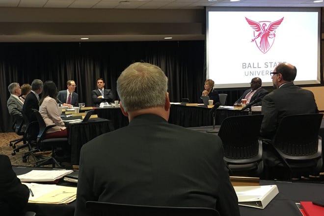 Ball State University Treasurer Alan Finn, right, addresses the board of trustees on Dec. 13.