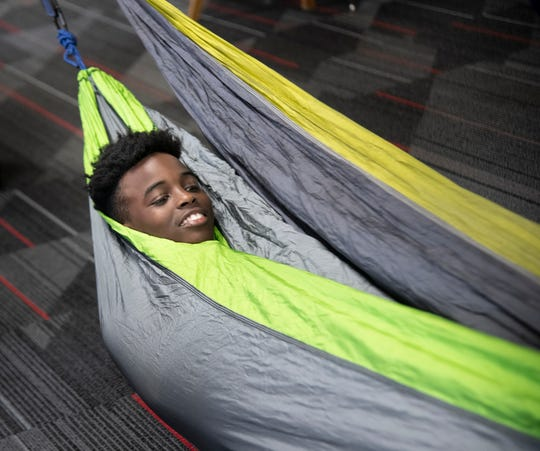 Eighth grader Mailk Dobbins tries out a hammock during the mentor lunch program at Wright Middle School on Thursday, Dec. 12, 2019.