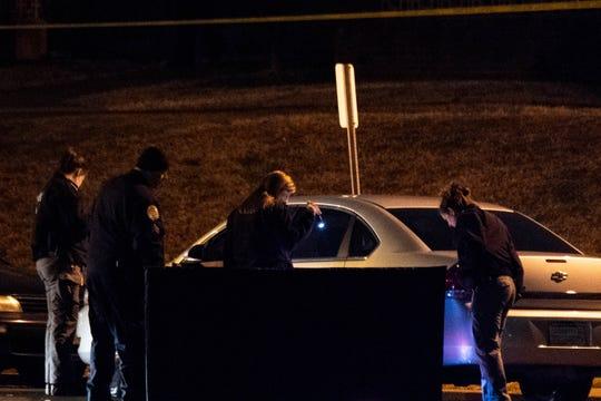 Metro Nashville Police investigate a homicide at the Edgehill Apartments Thursday, Dec. 12, 2019, in Nashville, Tenn.