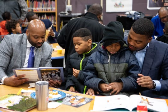 Xavier Purdy, from left, Tyrell Kirkwood, Tykese Kirkwood-Welch and Dameion Cowans read together during Fatherhood Friday on Dec. 13, 2019, at Buena Vista Elementary in Nashville.