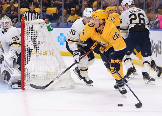 Nashville Predators forward Daniel Carr (26) controls the puck during the first period against the Buffalo Sabres on Thursday.