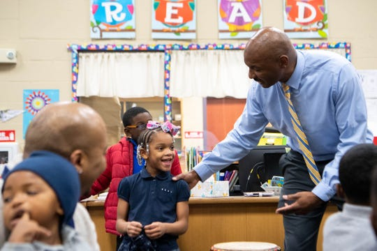Mailayah Rouse, 6, is asked to demonstrate a smile by Michael Pratt, right, during Fatherhood Friday at Buena Vista Elementary in Nashville on Dec. 13, 2019.