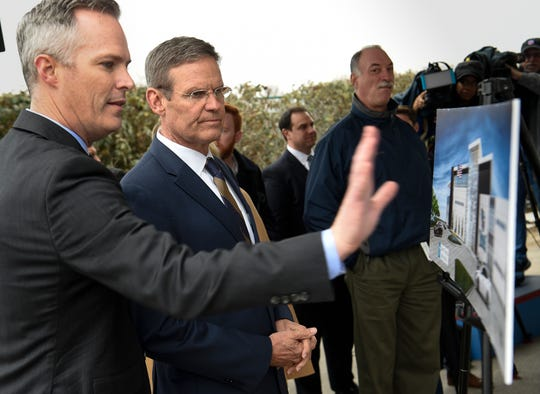 Tennessee Titans Vice President and General Counsel Burke Nihill shows Gov. Bill Lee a rendering of their new facility during a groundbreaking ceremony for its expansion at Saint Thomas Sports Park Friday, Dec. 13, 2019 in Nashville, Tenn.