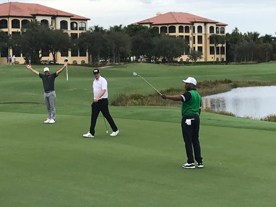 Ryan Palmer, far left, and Harold Varner III celebrate after Varner made a birdie putt on No. 18 in the first round of the QBE Shootout on Friday, Dec. 13, 2019. That tied the scramble record of 17-under 55.