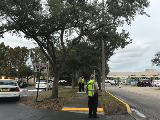 Collier County sheriff's deputies stand outside Pine Ridge Middle School on Friday afternoon, Dec. 13, 2019, after the still was in lockdown beginning at 1:24 p.m. Deputies determined there was no threat and normal activities have resumed at the school on the northeast corner of Pine Ridge and Goodlette-Frank roads.
