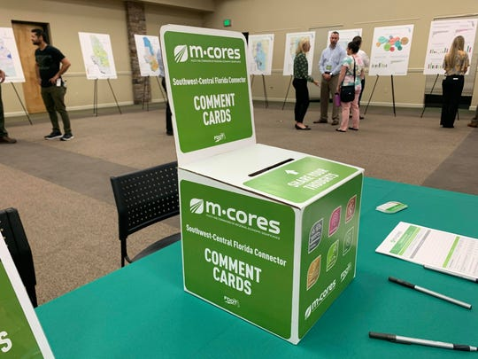 Attendees of the M-CORES community open house in Naples are given the opportunity to provide comments on the project on Thursday, Dec. 12.