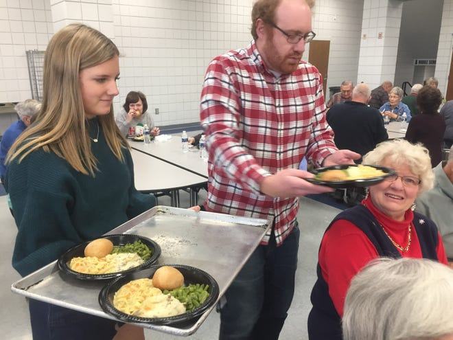 GHS sophomore Avery Koester and Guidance Counselor Cody Masters serve up meals at the Dec. 13 Christmas lunch and concert.