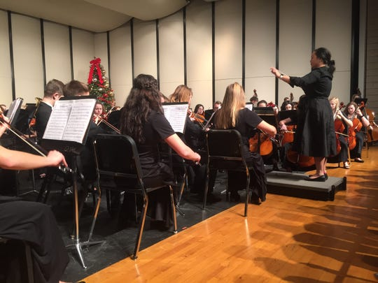 """The Dec. 13 concert opened with a performance of """"The Hallelujah Chorus,"""" performed by the combined ensembles."""