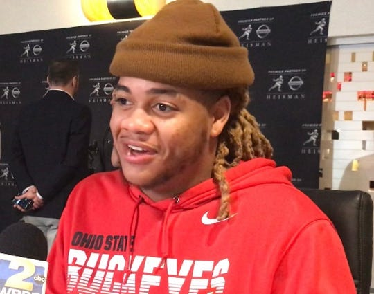 Ohio State star defensive end Chase Young speaks to reporters as part of Heisman festivities in New York City.