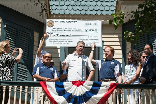 Freeholders Pat Lepore, Bruce James, and John W. Bartlett presenting a check to the Botto House on Labor Day of 2015.
