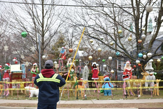 The home and office of Dr. Wayne Gangi is covered in his corner lot on Cover St with a spoof of the Twelve Days of Christmas, in Clifton, N.J. on Friday Dec. 13, 2019.