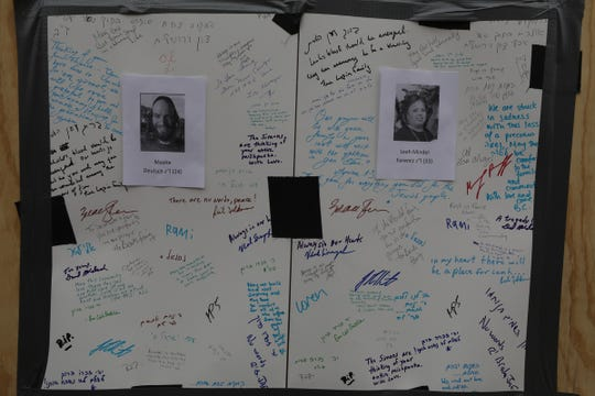 Memorials written to victims are posted to the plywood covering the Kosher Market on December 13, 2019 following Tuesday's shootout in Jersey City that left six people dead.