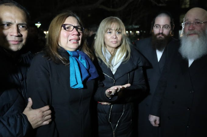 Martha Freire wife of Douglas Miguel Rodriguez Barzola, who was killed Tuesday, is shown at a candlelight vigil in Jersey City Thursday night. She thanked the Jewish community for treating him well.