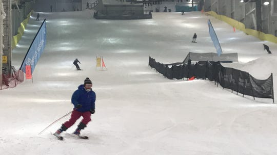 Three senior members of the Ridgewood High School ski team on Wed., Dec. 11, 2019, tested out Big Snow, the first-of-its-kind indoor ski and snowboard park at American Dream in East Rutherford. Jane McKinley skis down the slope during a test run.