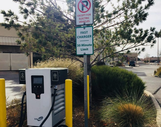 A public electric vehicle fast charging station in Albuquerque limits use to 30 minutes.