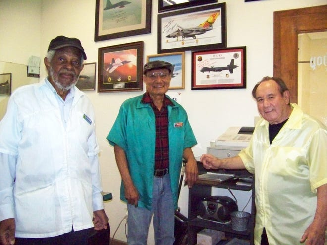 "Club Holloman barbers Macario (""Mac"") Bitela, Virgil George, and Chuy Holguin."