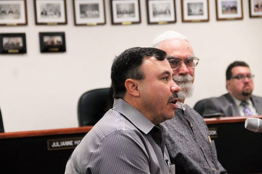 Lincoln National Forest Sacramento District Ranger Randall Chavez speaks during the Otero County Commission meeting Dec. 12.   Seated next to him is Otero County Public Land Use Advisory Committee member Walt Coffman.