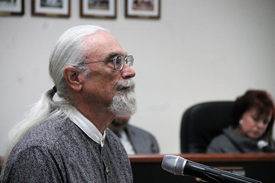 Otero County Public Land Use Advisory Committee member Walt Coffman speaks during the Otero County Commission meeting Dec. 12.