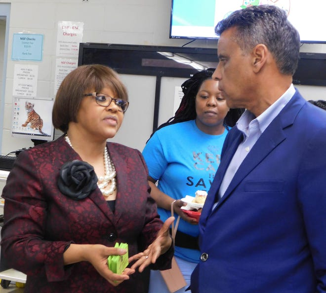Opelousas Junior High principal Monica Fabre, seen here last year speaking with St. Landry Parish District Attorney Charles Cravins, is accused of changing student grades.
