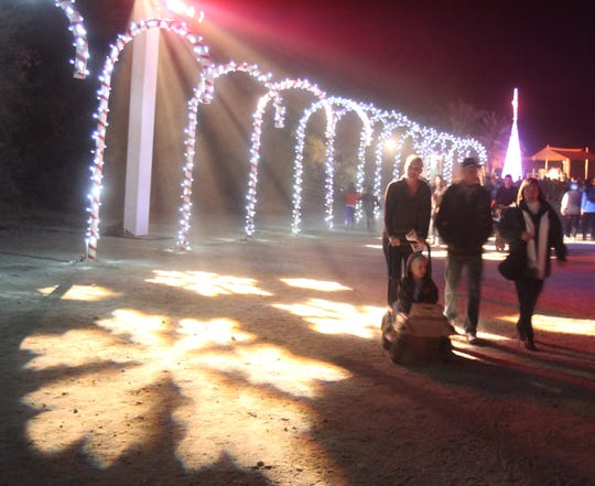 "Guests  at the  opening night of the Living Desert Wildlights  walked over giant snowflake lights on the ground Friday November 23, 2012. This year's  theme is ""Holidays Around the World"" with 750,000 Wildlights for the 20th season. Wildlights can be seen 6:00-9:00 p.m. Thursday, Friday and Saturday.  Wade Byars, The Desert Sun"