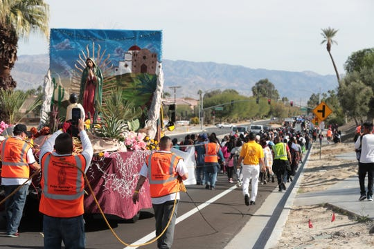 Thousands of people walk along Frank Sinatra Drive in Palm Desert, Calif., as part of the Virgen de Guadalupe pilgrimage from Palm Springs to Coachella on December 12, 2019.