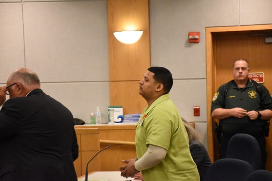 Markquise Wallace stands at the defendant's table at his Nov. 13 sentencing hearing at the Escambia County Courthouse.