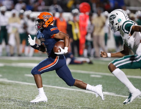 Escambia senior DT Gideon races for a touchdown after a pass from AV Smith in Thursday's class 6A state championship game against Miami Central.