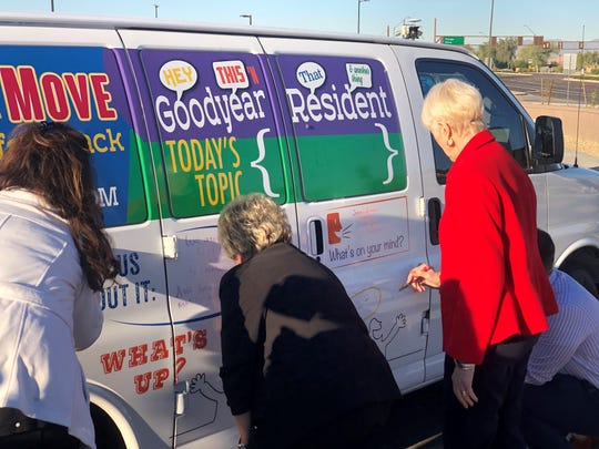 "Goodyear City Councilmembers Sheri Lauritano, Wally Campbell and Mayor Georgia Lord signed the city's ""Topcs On the Move"" van with pro-Trader Joe's messages."