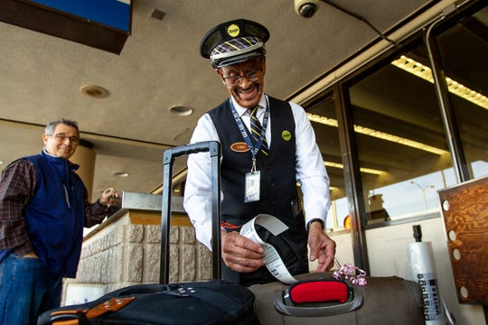 Lou Davis, seen at Sky Harbor on Dec. 3, 2019, says he doesn't plan to retire, because his job helps keep his mind sharp and gives him something to do.