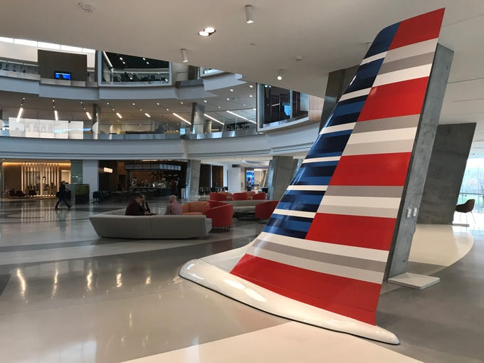 Tail of an American Airlines plane in the lobby of the airlilne's new headquarters.