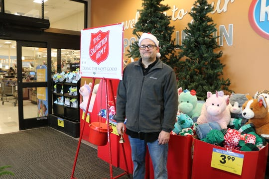 Local volunteer bell ringer Alex Szabo helps raise donations for The Salvation Army at the local Kroger in Port Clinton on Friday morning.