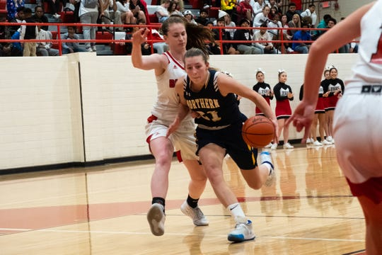 Port Huron's Emma Trombly defends against Port Huron Northern's Ally Shagena (21) during their game Thursday, Dec. 12, 2019, at Port Huron High School.
