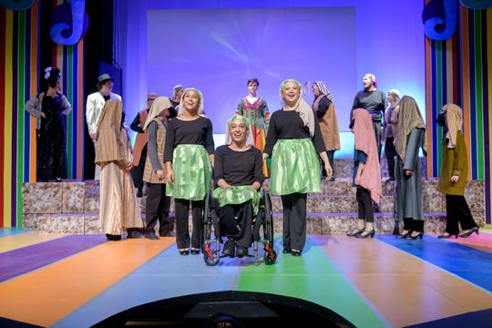 """Joci Scott, center, performs with the cast of """"Joseph and the Amazing Technicolor Dreamcoat"""" at Weathervane Playhouse in Akron."""