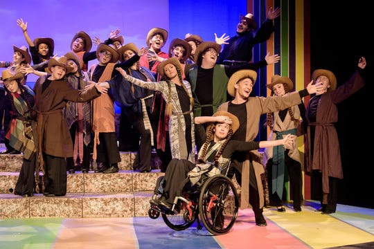 """Joci Scott, 21, performs in her wheelchair with dance partner Judah Callahan in Weathervane Playhouse's """"Joseph and the Amazing Technicolor Dreamcoat."""" in Akron."""