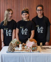 """Girl Scout Troop 60179 won second place in the Junior Category for """"Polar Plunge"""" in the Dec. 8, 2019 competition at the Mohonk Mountain House. Shown with their creation are Brianna Jonietz, left to right, Maeve Cadabal and Caitlin Becker."""