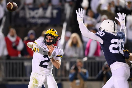 Oct 19, 2019; University Park, PA, USA; Michigan Wolverines quarterback Shea Patterson (2) passes the ball as Penn State Nittany Lions defensive end Adisa Isaac (20) pressures during the third quarter at Beaver Stadium. Mandatory Credit: Rich Barnes-USA TODAY Sports