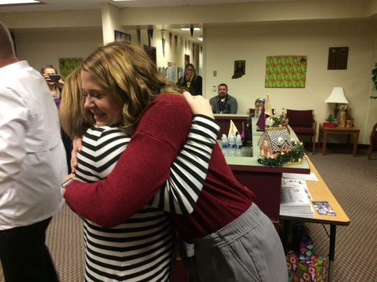 Kassidy Oliger is congratulated by her mother, Amy Oliger, after she was awarded a Lilly Endowment Community Scholarship.
