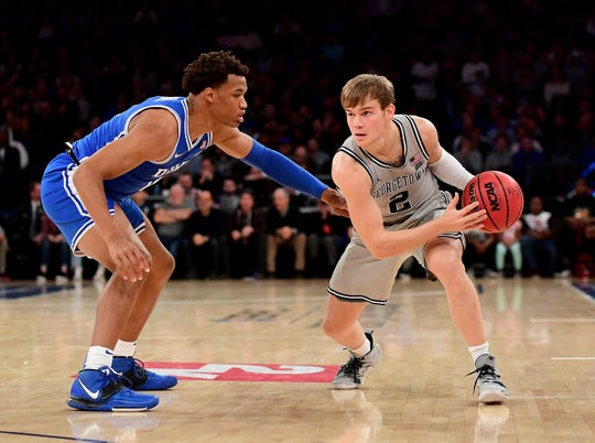 Mac McClung, right, of the Georgetown Hoyas drives past Wendell Moore Jr. of the Duke Blue Devils during the first half of their Nov. 22 game at Madison Square Garden.
