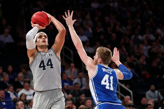 Georgetown center Omer Yurtseven (44) shoots as Duke forward Jack White (41) defends during the second half of an NCAA college basketball game in the 2K Empire Classic, Friday, Nov. 22, 2019 in New York. Duke won 81-73.