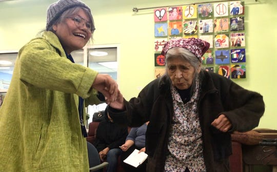 Bessie Mackay of West Covina, California, right, dances to live music at OPICA Adult Day Care Services in Los Angeles with Margaret Hernandez, an intern at OPICA.