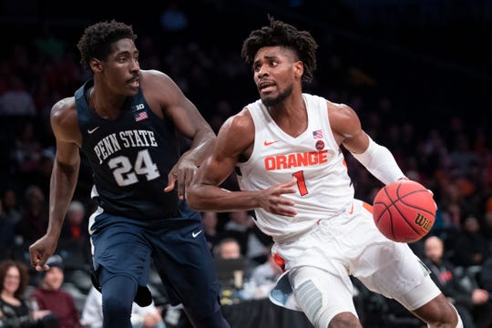 Syracuse freshman Quincy Guerrier, right, is averaging 6.4 points in 18.6 minutes per game this season.