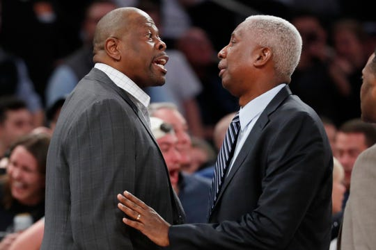 Georgetown head coach Patrick Ewing gets upset as his assisant coach Louis Orr tries to calm him down after Ewing drew a technical foul during the second half of an NCAA college basketball game against Duke in the 2K Empire Classic, Friday, Nov. 22, 2019 in New York.Orr was one of Jim Boeheim's first recruits at Syracuse.