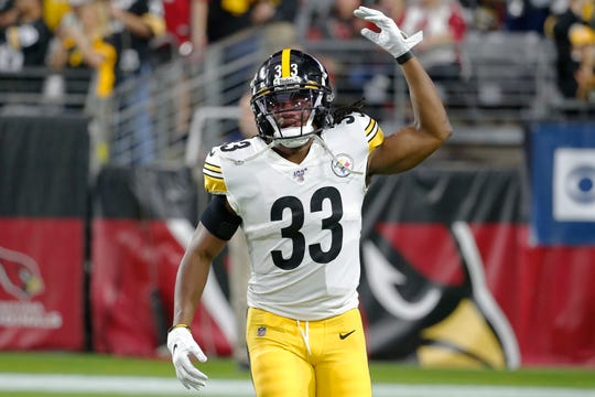 Pittsburgh Steelers running back Trey Edmunds (33) gestures during an NFL football game against the Arizona Cardinals, in Glendale, Ariz.  Trey and Steelers safety Terrell Edmunds face their little brother, Tremaine, a linebacker with the Buffalo Bills, Sunday at Heinz Field.
