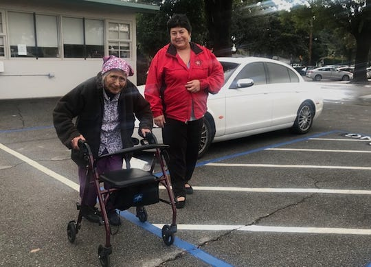 Bessie Mackay, left, of West Covina, California, leaves OPICA Adult Care Services in Los Angeles with her daughter Myra Taylor. It often takes them two and a half hours to get home in Los Angeles rush hour traffic, but the drive is worth the high-quality care Mackay receives at OPICA, said Taylor.