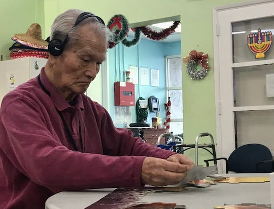 Clark Yamazaki, 89, of West Los Angeles works on a puzzle at OPICA Adult Day Care Services. He is a patient with UCLA's Alzheimer's and Dementia Care program.