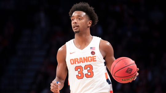 Syracuse forward Elijah Hughes handles the ball during the first half of an NCAA college basketball game against the Penn State in the consolation round of the NIT Season Tip-Off tournament. Hughes is coming off a career-high 33 points against Georgia Tech.