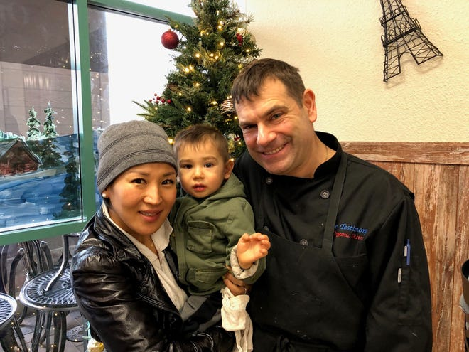 Le Testimony owner James Giaudrone with wife, Yumi, and son, Yisrael.